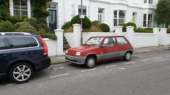 1994 Renault 5. (ManOfYorkshire) Tags: renault renault5 5 car auto moptoring automobile red 1994 parked onstreet everyday l205ucd petrol engine 1390cc 14litre transport brighton sussex french design wheeltrims steeringwheellock vehicle