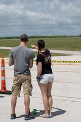 Airshow Spectators awaiting the B-2 Bomber (joncutrer) Tags: abilene abilenetexas texas travel tourism flight airplane airshow airfest airfest2019 dyess bigcountry aviation airplanes military usaf woman man couple pointing shorts