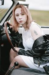 000008450021_21A (Stephen Garnett Photographic) Tags: nikon f6 35mm vw volkswagen beetle car film veedub classic dof bokeh 50mm slr f12 leather jacket girl driver nikkor