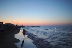 Running towards the sunset (velenux) Tags: pesaro sanlorenzo notte night stellecadenti shootingstars alumedicandela mare sea adriatico spiaggia beach shore running kids playing saintlawrence