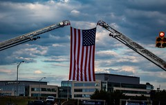 American Flag flying being held up by the Arlington Fire Department ladder (barrob photos) Tags: arlingtonva crystalcity runners america 911 memorial 5k tdameritrade police fire sheriff sky clouds pride