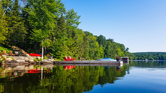 Red Chairs, Docks And Lake (Dallas K. Sanders) Tags: cottage clearwater adobelightroom summervacation calmwater lake kayak bluewater bluesky freshwater august19 calm dock huntsville canada galaxynote8 vacation cottagelife august ontario travelswithmom cleanwater 2019 lightroom canoe
