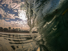 Colorful Beach Sunrise reflected by a big glassy ocean wave breaking over viewers head. View from in the water. (davidweedallphotography) Tags: photohopexpress rise shine gopro lagunabeach beach california nature photography ocean water naturephotography waves surfing sunrise sunlight light lightwater adventure explore natgeo yourshotphotographer sand coast coastal californiacoast oceanphotography waterphotography cavanimages adobe photos beachesoftheworld beaches