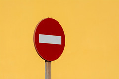 Red sign and yellow wall (Jan van der Wolf) Tags: map194632v simple simpel sign red verkeersbord trafficsign roadsign minimalism minimalistic minimalisme minimal minimlistic wall muur yellow geel lanzarote