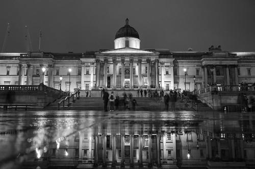 Walking by Trafalgar Square at night