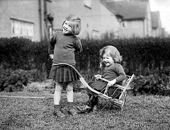 VINTAGE GLASS NEGATIVE 133 (Nigel Bewley) Tags: littlegirls dogcart play playing childhood happydays 1920s britain uk glassnegative negative quarterplate largeformat vintagephotograph bygonedays oldphotograph oldphoto oldpicture blackandwhite kodakmoment familyhistoryroadshow unlimitedphotos nigelbewley appicoftheweek