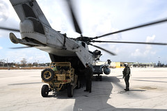 A U.S. Air Force MRZR tactical vehicle is off-loaded from a Marine Corps CH-53 Super Stallion helicopter.