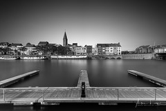 Portus Ganda III (Alec Lux) Tags: bw bnw leie art belgie belgium black blackandwhite boat building buildings city cityscape exterior facade fine fineart gent ghent haida haidafilters harbour jetty longexposure outdoor outside pier pontoon port river skyline urban white