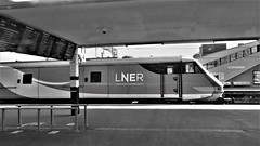 LNER Peterborough. (ManOfYorkshire) Tags: lner londonnortheasternrailway railway train 82208 208 dvt drivingvantrailer vantrailer intercity225 set ic225 electra eastcoast platform peterborough bw blackwhite sunday morning quiet quieter station stop departs departure boards departureboards