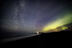 Streaming light .. Black sands beach lighthouse Iceland , Milky Way to the left and Aurora Borealis to the right .. (Nathan Peplow) Tags: nathanpeplow aurora milkyway seascapes auroraborealis northernlights southerniceland iceland blacksandsbeach