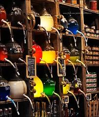 Colourful shop! (kimbenson45) Tags: lyon france bottles shop store liquids colours colors jars oldfashioned