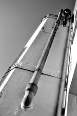 Pipe to the sky (Christina 25) Tags: pipe wall building tube sky construction construct connected monochrome blackwhite high above architecture mechanical stone digital photography nikon nikond3100 brussels belgium installation pipefitter shadows metal urban city windows symmetry geometrical geometry nooks indentations house home outdoors outside up everyday morning day long oblong
