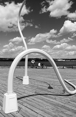 Street lights not needed (halifaxlight) Tags: canada novascotia halifax waterfront harbour boardwalk streetlights artwork sitting looking clouds summer bw shadows men benches lifepreserver artinstallation