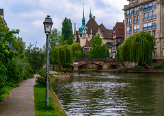 Walk by the River (dlerps) Tags: amount city daniellerps eu europe fr france frankreich french lerps photography sony sonyalpha sonyalpha99ii sonyalphaa99mark2 sonyalphaa99ii strasbourg summer urban httplerpsphotography lerpsphotography river water shore coast building bridge lamp carlzeiss planar5014za planart1450 path architecture buildings carlzeissplanar50mmf14ssm