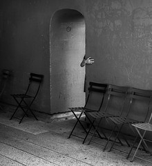 Give a hand (explore) (Dan Fleury Photos) Tags: locations newyorkcity photography hand chair blackandwhite mono doorway