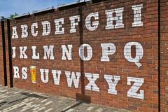 Alphabet, Glasgow, UK (Robby Virus) Tags: glasgow scotland uk unitedkingdom gb greatbritain wellpark brewery beer brewing street art brick wall lager smug graffiti mural artist tennents