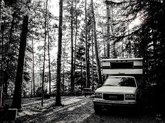 Cascade Truck Camper (by Deborah K Photography) Tags: gmctruck dustyroadphotos camper picnictable landscape rurallife campground water canadianlife minimumcolour bw outdoor lake evening shoreline campsite deborahkphotography nostalgia canadian ruralphotography camps candid northernlife dustyroadpics alberta minimalism canong12 canada disconnect camping blackandwhite monochrome