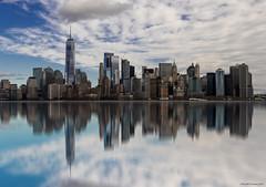 Skyline in blue (ricardocarmonafdez) Tags: newyork manhattan skyline skyscraper sky rascacielos horizon cielo nubes clouds arquitectura architecture reflejos reflections edition processing nikon d850 espejo mirror simetría symmetry