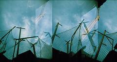 finestra a un cel devastat / ventana a un cielo devastado (Luis G. Vesperinas) Tags: abstract architecture arquitectura buildings city composition entropy gentrificación gentrification film finestra megamáquina holga lomography silhouette window silueta blue bricks lleida multiple panoramic lomo urban street sky xpro
