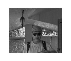 the photographer with sunglasses (Armin Fuchs) Tags: arminfuchs nomansland selfportrait selfy mirror 6x7 niftyfifty grain lamp cap sunglasses véranda diagonal anonymousvisitor thomaslistl wolfiwolf jazzinbaggies