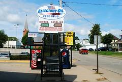 Allegiant Oil - Platteville, Wisconsin (Cragin Spring) Tags: platteville plattevillewi plattevillewisconsin southwestwisconsin wisconsin wi allegiantoil gasstation pepsi coke cocacola pop soda street cokemachine pepsimachine