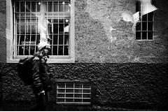 LEONARDO (stefankamert) Tags: leonardo lindau street textures tones window blur reflections people walking blackandwhite blackwhite noir noiretblanc ricoh ricohgr grii gr 28mm stefankamert bw