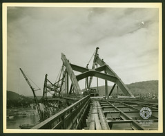 Fort Henry Bridge Construction (Ohio County Public Library) Tags: wheelingwv wheeling forthenrybridge fthenrybridge construction bridgeconstruction ohioriver cranes