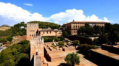 The Fortress & Alhambra (Peter.S.Roberts) Tags: interesting thefortressalhambra granada andalusia espania fort castle palace buildings royal outdoor landscape fortification walls stone turrets old medievil bushes trees leaves branches mountains spire houses dwellings doors windows clouds bluesky hot afternoon bright shadows colours colourful grass grasses walkways paths hedging hedges greenery view pov dof details ancient ruins historic historical spanish architecture perspective grand monumental epic steps archways arches pillars columns stonework masonry