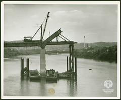 Fort Henry Bridge Construction (Ohio County Public Library) Tags: wheelingwv wheeling forthenrybridge fthenrybridge construction bridgeconstruction ohioriver barges barge top mill