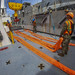 Sailors conduct a crane operator training evolution aboard the USNS Dahl
