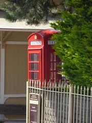 Cheltenham Race Course Station on the GWSR - red phone box (ell brown) Tags: cheltenham cheltenhamspa gloucestershire england unitedkingdom greatbritain spatown tree trees cotswolds gloucestershirewarwickshiresteamrailway gwsr gloucswarkssteamrailway gwr cheltenhamracecoursetobroadway cheltenhamracecoursestation cheltenhamracecourse prestbury ramp phonebox redphonebox