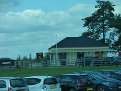 Cheltenham Race Course Station on the GWSR (ell brown) Tags: cheltenham cheltenhamspa gloucestershire england unitedkingdom greatbritain spatown tree trees cotswolds gloucestershirewarwickshiresteamrailway gwsr gloucswarkssteamrailway gwr cheltenhamracecoursetobroadway cheltenhamracecoursestation cheltenhamracecourse prestbury coach carpark