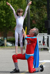 Showing Off His Pride & Joy (Anthony Mark Images) Tags: pridejoy dad father daughter people portrait buskers streetperformers entertainers canada circusact ontario waterloo waterloobuskercarnival matvelvetcharlieshow matvelvet redsuit bluetrunks smilehappy kneeling sweet bluecape whitetights nikon d850 flickrclick martinvarallo lovely touching excited