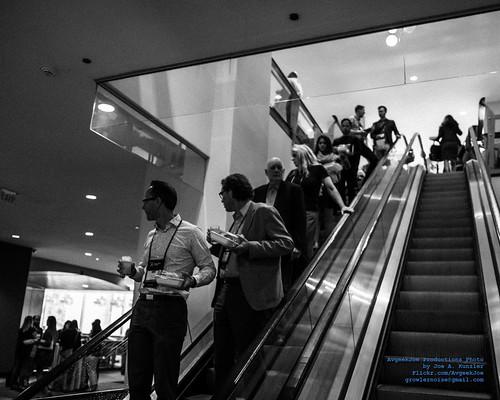 RailVolution Attendees On the Escalator in Monochrome