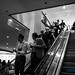 RailVolution Attendees On the Escalator in Monochrome