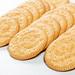 Round cookie on white wooden background