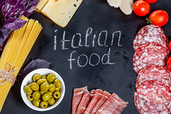 Italian food products with tag on black background (wuestenigel) Tags: sausage cut slice portion background red salami olives ham cooked lettering cheese white basil piece concept bacon kitchen preparation leaves tomato food italianfood bread pickled purple cooking spaghetti black green fresh sliced freshness tag noperson keineperson essen wood holz garlic knoblauch kochen health gesundheit ingredients zutaten pepper pfeffer desktop nutrition ernährung leaf blatt board tafel summer sommer vegetable gemüse rustic rustikal stilllife stillleben fall fallen delicious köstlich chili