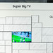 Samsung Television: Soccer game on a Super Big TV QLED in a white wall