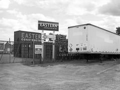 (geowelch) Tags: toronto thestockyards newtopographics urbanlandscape humanalteredlandscape glenscarlettroad industriallandscape film 120 645 kodakbw400cn mediumformat 6x45 c41 blackandwhite fujigs645s epsonperfection4870photo trailer