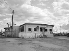 (geowelch) Tags: toronto thestockyards newtopographics urbanlandscape humanalteredlandscape glenscarlettroad industriallandscape film 120 645 kodakbw400cn mediumformat 6x45 c41 blackandwhite fujigs645s epsonperfection4870photo