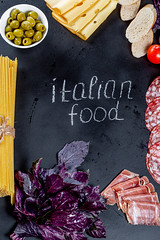 "The inscription ""Italian food"" on a black background with a frame of products of Italian cuisine (wuestenigel) Tags: sausage cut slice portion background red salami olives ham cooked lettering cheese white basil piece concept bacon kitchen preparation leaves tomato food italianfood bread pickled purple cooking spaghetti black green fresh sliced freshness tag noperson keineperson essen wood holz stilllife stillleben leaf blatt fall fallen garlic knoblauch love liebe desktop color farbe flower blume christmas weihnachten nature natur retro health gesundheit card karte kochen decoration dekoration rustic rustikal art kunst"