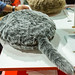 Robotic cat pillow by Qoobo: a cushion with wagging tail