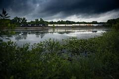 Thundering across the Lake (benpsut) Tags: trains railroad ns nsfortwayneline nsftwayneline moody dark lake trailer
