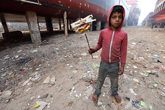 Bangladesh, street kid collects trash in Dhaka (Dietmar Temps) Tags: abandoned asia bangladesh boy child culture developingcountry dhaka homelessness human humanity kid loneliness male orphan outdoor people person poor poverty streetchildren streetkids streetyouth young