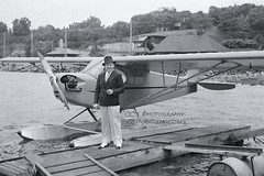 Dapper Dude with Plane - NYC c1940 (http://www.yashicasailorboy.com) Tags: nyc newyork airplane seaplane river man 1930s floatplane taylorcraft pipercub j3
