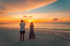 Taking photos of... (icemanphotos) Tags: couple taking photos sunset landscape view sea beach vacation honeymoon camera gear shot image photography