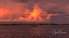 Any Port In A Storm (Thüncher Photography) Tags: fujifilm gfx50s mediumformat scenic landscape waterscape outdoors sky clouds colors reflections sunset storm sailboat florida southwestflorida gulfcoast ftmyersbeach hurricanedorian stormclouds fineartphotography