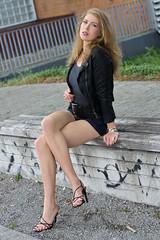 Chiara 17 (The Booted Cat) Tags: sexy cute teen model girl long blonde hair legs heels highheels feet foot barefoot barefeet leather jacket denim jeans hotpants sandals