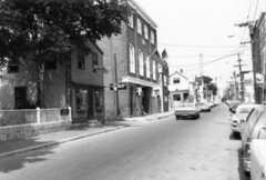 Derby Street, 1978 (Salem State Archives) Tags: scph02082 derbystreet salemmaritime salemmassachusetts westindiagoodsstore st joseph hall cars shopping