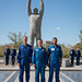 The backup crewmembers for the next launch to the space station in front of a statue of Yuri Gagarin